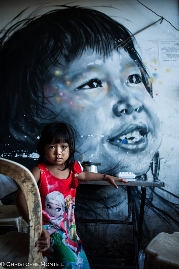 street art young girl, Phnom Penh, Cambodia