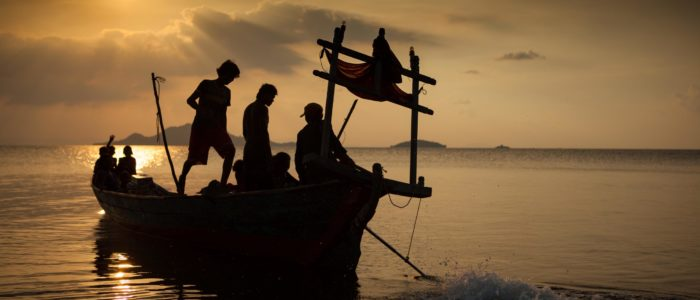 family of fishermen ready to leave to their island, Kep, Cambodia